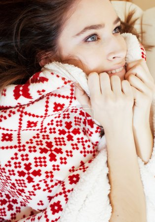 yong pretty brunette girl in Christmas ornament blanket getting warm on cold winter, freshness beauty concept