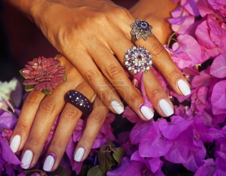 bright colorfull shot of african tanned hands with manicure