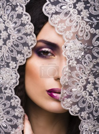 beauty young woman throw white lace close up, bride under veil,