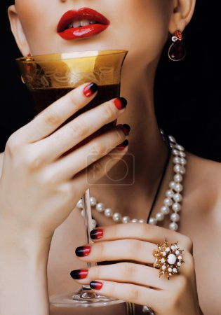 beauty stylish redhead woman with hairstyle and manicure wearing jewelry
