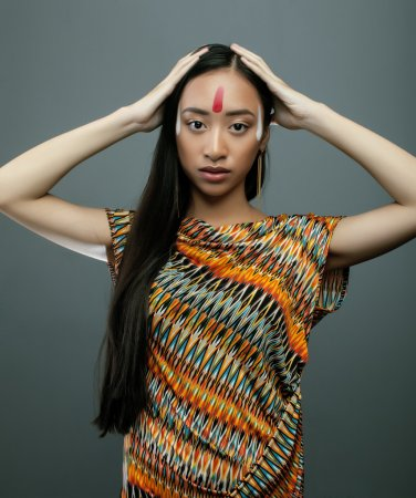 beauty young asian girl with make up like Pocahontas, red indians woman fashion