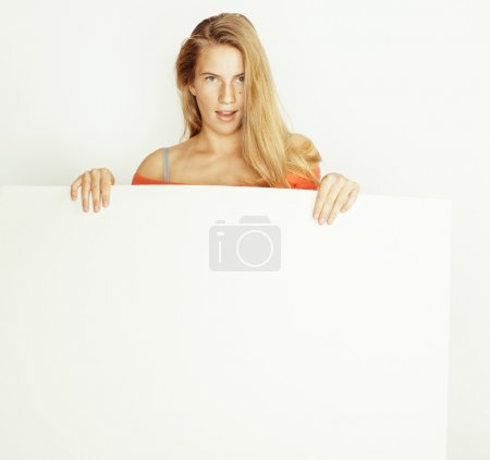 young pretty blond woman holding blank white board with copyspace isolated