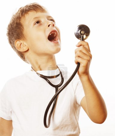 little cute boy with stethoscope playing like adult profession doctor close up smiling