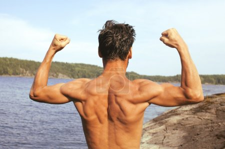 handsome young man at beach, hot vacations on lake close up, muscle from back