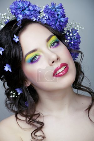 Beauty young woman with flowers and makeup close up, real spring beauty girl floral