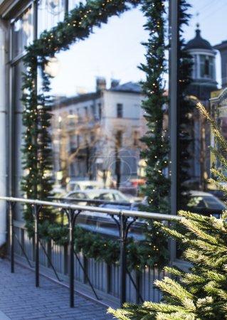 citylife on Christmas. Decoration of showcase outside street, gift card background.