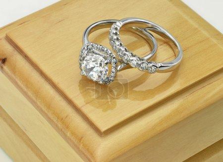 Pair of Diamond rings Vintage Cushion Cut Halo Diamond Ring with Diamond Wedding Ring on Wood Ring Box