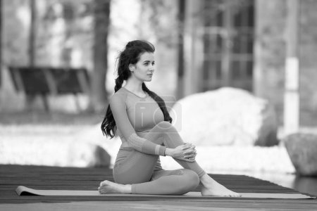 Photo for Beautiful young woman doing yoga exercise, Outdoor - Royalty Free Image