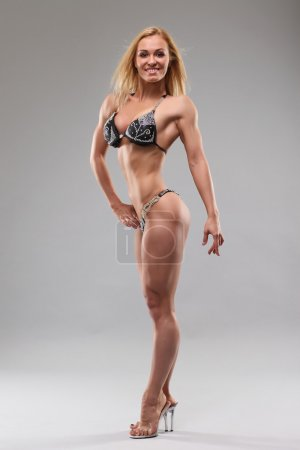 Woman with perfect athletic body . fitness bikini...
