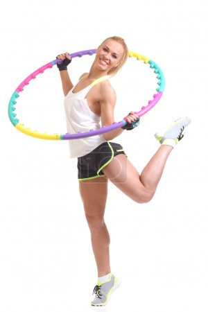 Photo for Woman holding hula hoop - Hula Hoop Exercises - Royalty Free Image