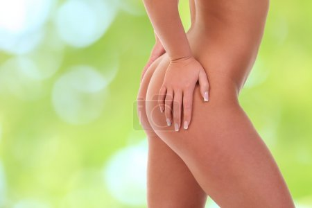 pinches her thigh to control cellulite