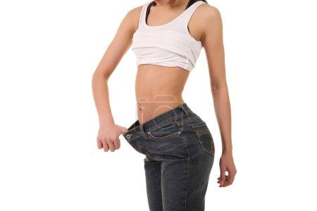 woman showing big pants
