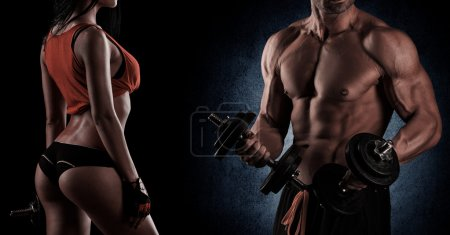 Photo for Young beautiful couple, bodybuilding, posing in front of the camera, sexy, strong - Royalty Free Image
