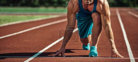 Photo for Young muscular athlete is at the start - Royalty Free Image