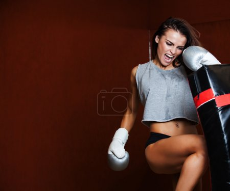 Photo for Punching bag, on the background wall of red brick. - Royalty Free Image