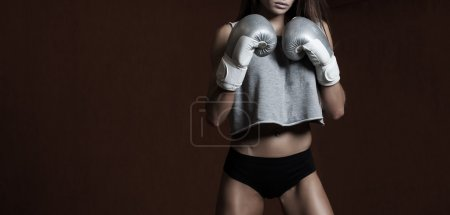 Young sexy girl with boxing gloves.
