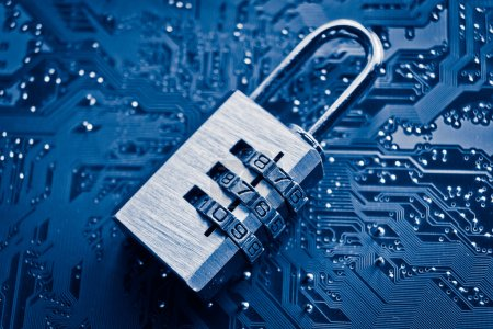Photo pour Data Security concept, lock on computer board background blue colors - image libre de droit