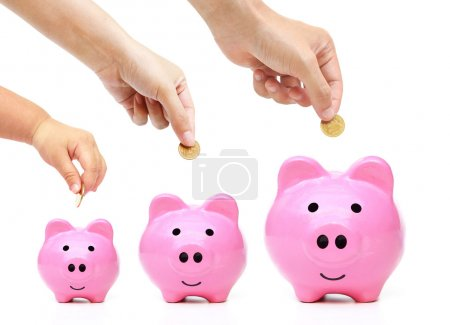 family do saving money in green piggy banks