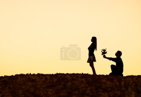 A man kneeling down begging for love