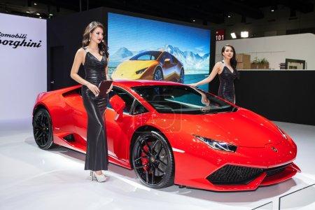 Photo for BANGKOK - AUGUST 16 :An unidentified female presenter models at Lamborghini booth at Big Motor Sale 2014 on June 16,2014 in BITEC ,Bangkok, Thailand. - Royalty Free Image