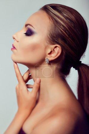 Close up fashion portrait. Model shooting. Purple makeup.