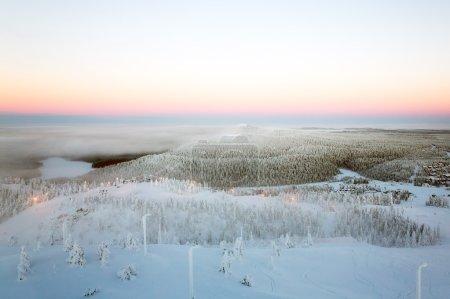 Hilly winter landscape. Sunset