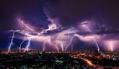 Lightning storm over city in purple light...