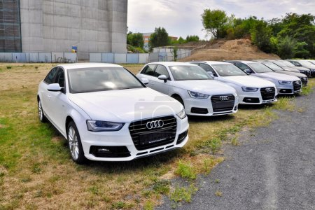 Cars Audi parks in row