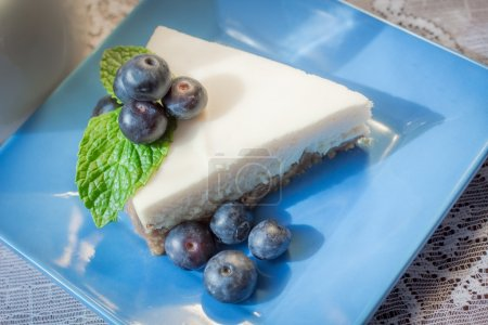Slice of plain New York Style cheesecake garnished...