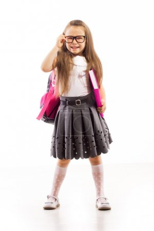 Schoolgirl with pink satchel  in glasses holding book
