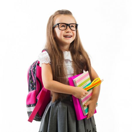 Photo for Schoolgirl with pink satchel  in glasses holding book,  isolated white background. Education and school concept - Royalty Free Image