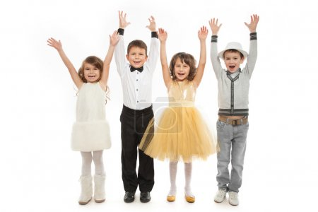 Group of happy kids in celebratory clothes.