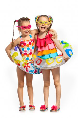 Happy kids in swimsuit and inflatable rings
