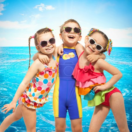 Happy kids in swimsuit at sea