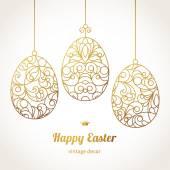 Golden ornamental eggs for your Easter design