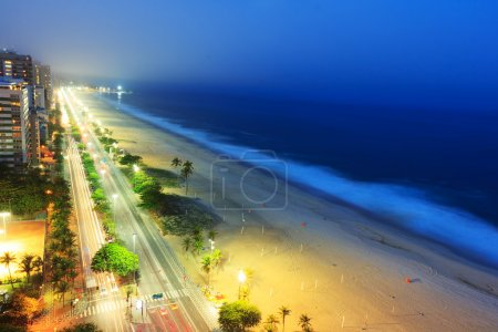 Night view of Ipanema beach after sunset,  with fog from the sea