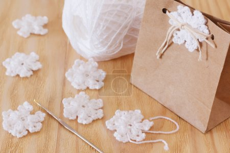 White crochet snowflakes for Christmas decoration of package gif