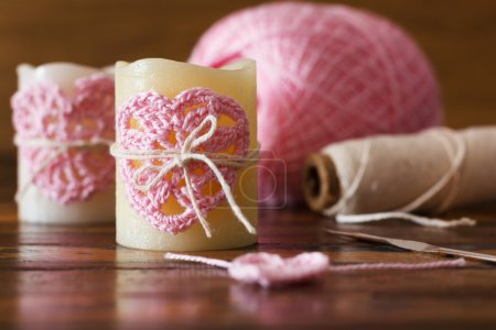 Two candle with  pink crochet handmade heart for Saint Valentine