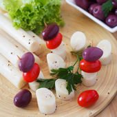 Canape of Heart of palm (palmito), cherry tomatos, olives