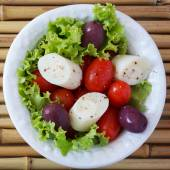 Fresh salad of heart of palm (palmito), cherry tomatos, olives