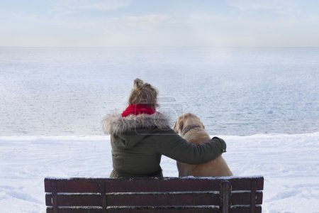 Photo for Woman with dog on bench - Royalty Free Image