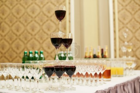 pyramid of glasses with red wine