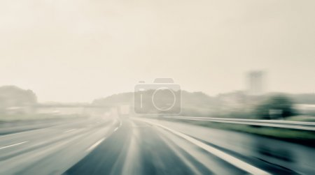 Photo for Driving on a highway on a rainy and misty day - Royalty Free Image