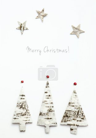 Christmas tree shaped birch bark. Greeting card with text  Merry