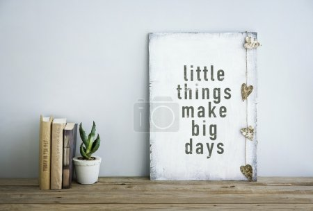 Photo for Motivational inspirational poster quote LITTLE THINGS MAKE BIG DAYS. Room decoration american or scandinavian style  with books, succulent in the pot and heart shaped garland. - Royalty Free Image