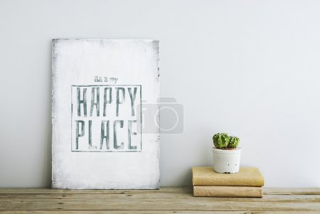 Foto de Motivational poster quote THIS IS MY HAPPY PLACE on the white wall with books and cactus - Imagen libre de derechos