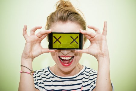 Woman with smartphone and crazy eyes