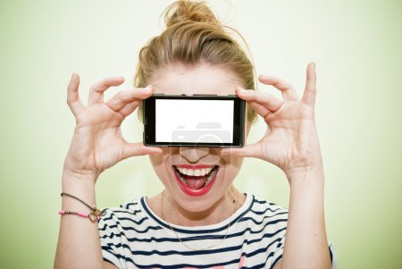 Woman with smartphone over eyes