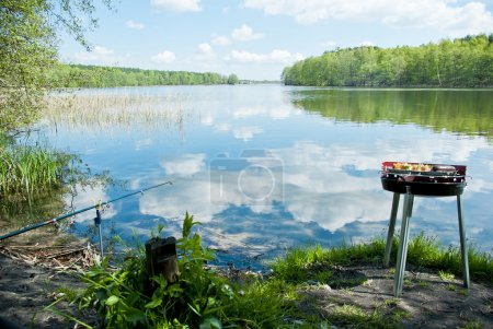 Photo for Fishing and grilling at the lake in the forest, natural landscape. - Royalty Free Image