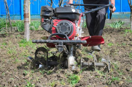 a person cultivates land motor-block